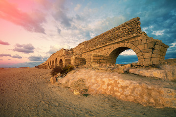 Old Aqueduct on the beach  in Caesarea, Israel