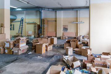 a lot of boxes in the dirty warehouse of the factory