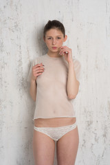 beautiful girl posing in white lingerie in studio