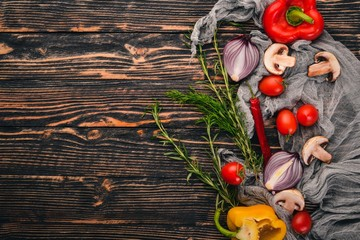 Preparation for cooking on a wooden background. Top view. Free space for text.