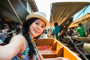 attractive young female tourist taking selfie