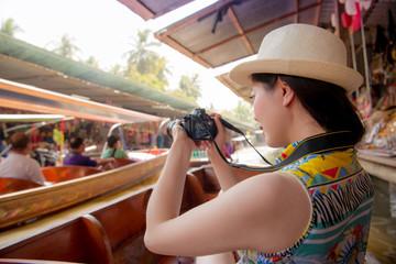 girl traveler using personal camera taking video