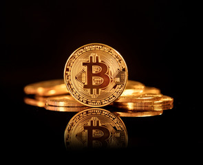 Bitcoin BTC the new virtual internet Cryptocurrency isolated on black background.