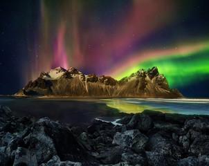 Vestrahorn Stockknes mountain range with aurora borealis, Iceland.
