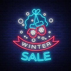 Winter sale of a poster in a neon style. Neon sign, bright flyer, glowing banner, night neon advertising on the theme of winter holiday discounts and sales. Vector illustration