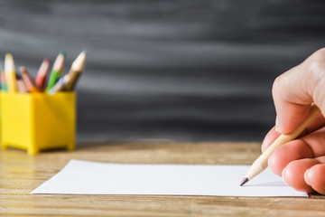 Artist painting a picture with pencil on white sheet. Art concept.