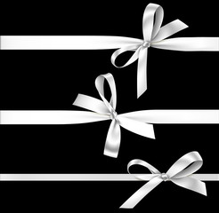 Vector set of silver bow with ribbon isolated on black background.
