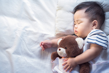 Newborn baby sleep with teddy bear
