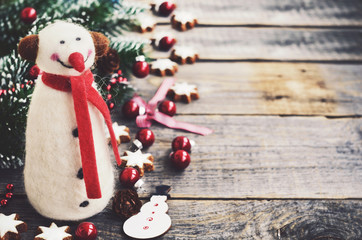 Winter decoration with snowman, christmas tree and gingerbread cookie stars