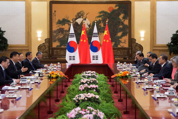 South Korean President Moon Jae-In and Chinese President Xi Jinping meet during a bilateral meeting at the Great Hall of the People in Beijing