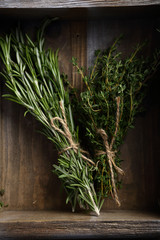 Bunches of Rosemary and thyme in crate