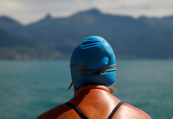 Swimmer Naunton looks on before her shift during her team attempt to swim a 70 km relay across Lake Leman in Evian-les-Bains