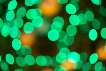 Abstract bokeh lights orange green red colorful background