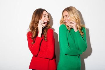Portrait of two pretty girls dressed in sweaters