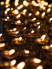 Burning candles in a Temple