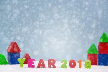 Year 2018 colorful wooden text on white wooden desk with Christmas decorations, Merry Christmas and happy new year concept.