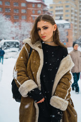 Stylish woman on winter street