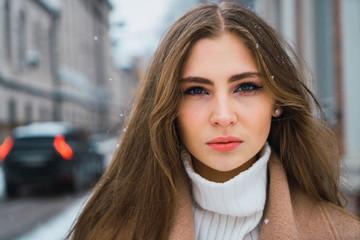 Sensual woman on winter street