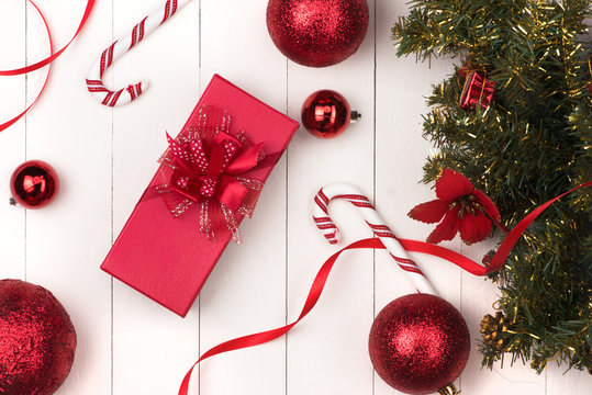 Flat lay of christmas ball, gift and cosmetic. Holiday Background. Beauty concept.