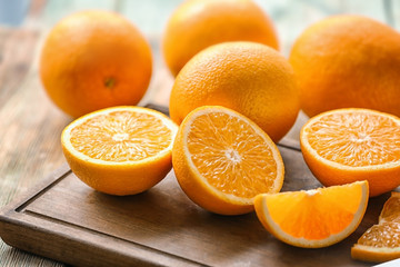 Fresh cut oranges on wooden board