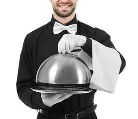 Waiter with metal tray and cloche on white background, closeup
