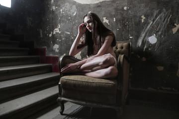 Beauty sitting in an armchair