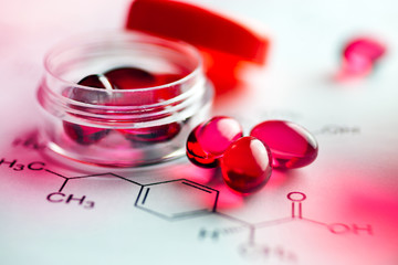Painkiller tablets - pink caps with molecules chemical formulas - healthcare and medicine