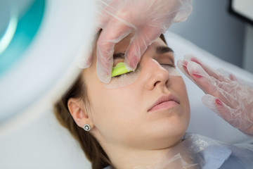 Eyelash Extension Procedure. Woman Eye with Long Eyelashes. Lashes, close up, selected focus