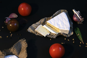 cheese brie and camembert with vegetable and spises