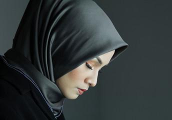 Portrait Muslim woman. Low key background, Woman Power Success concept