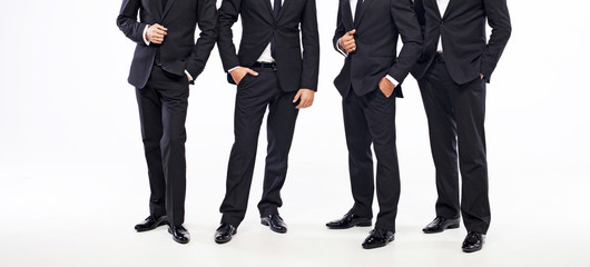 Four standing men