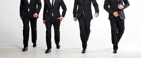 Four walking men