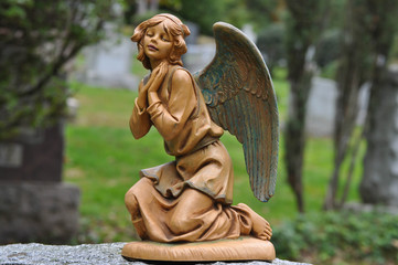 Female Angel Statue Kneeling and Praying with Spread Wings