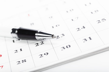 Check out the dates in a business calendar concept