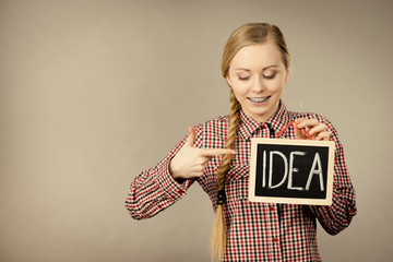 Happy positive woman holding idea sign