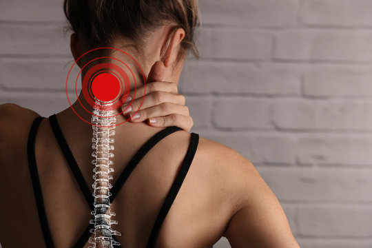 Woman suffering from back and neck pain. Incorrect sitting posture problems, Muscle spasm, rheumatism. Pain relief , chiropractic concept. Sport exercising injury