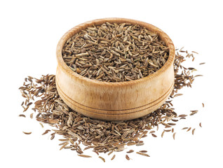 Cumin or caraway seeds in wooden bowl isolated on white background