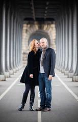 Romantic couple in Paris, woman kissing his cheek