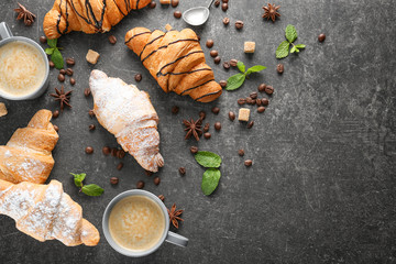 Delicious sweet croissants on dark background