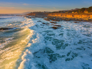 aerial view of surf at Moonstone Beach at sunset, Cambria, California