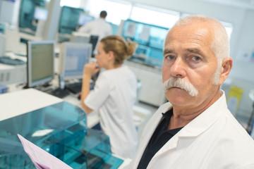 portrait of senior male doctor in laboratory