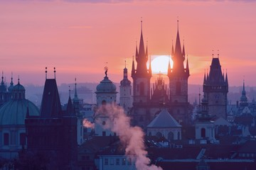 Rising Sun behind the Prague Towers