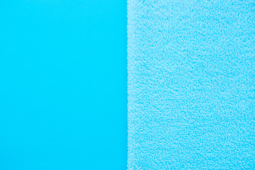 Vertical Background of two types of blue fabric - smooth and fluffy. Baby blue Soft fabric pastel textile texture. Blue towel terry cloth