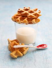 Homemade waffles on glass of yogurt. Toned. Low shallow focus