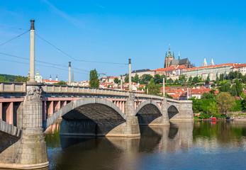 View of Prague Castle from Manes Bridge over Vltava river in Prague, Czech Republic