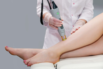 Hair removal cosmetology procedure from a therapist at cosmetic beauty spa clinic