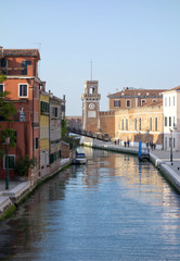 Canal, boats, and bridges in Venice,Spring, 2017.