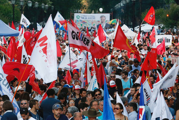 Supporters of Chilean presidential candidate Alejandro Guillier hold flags during the closing campaign rally in Santiago.