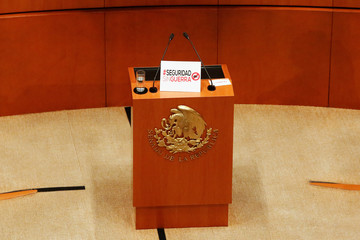 Placard reading #SecurityWithoutWar is seen at the podium of the Senate during the discussion of the Law of Internal Security, in Mexico City