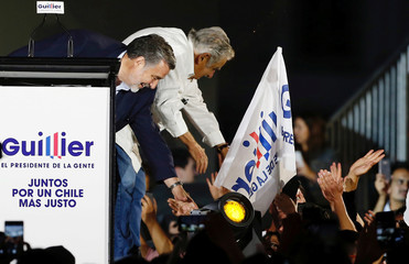 Chilean presidential candidate Alejandro Guillier and former Uruguayan president Jose Mujica attend a campaign closing rally in Santiago, Chile